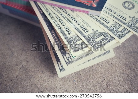 Dollars with book - stock photo