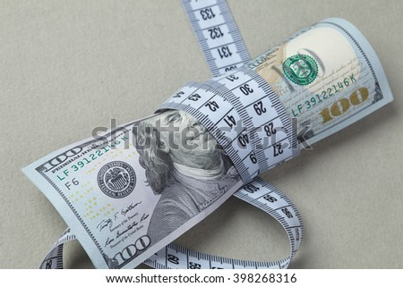 dollars with measuring tape