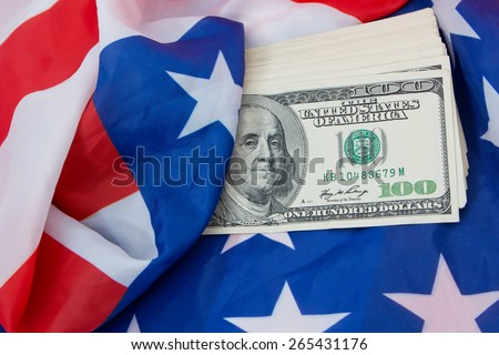 dollars wrapped in the US flag - stock photo