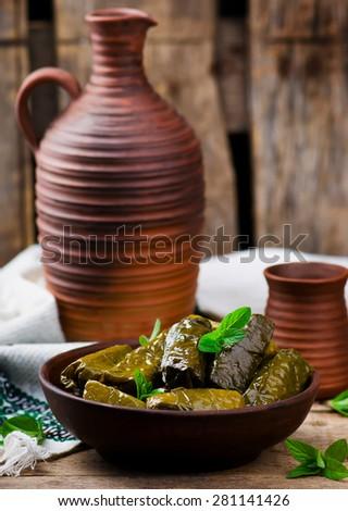 dolma ,greek traditional appetizer on ceramik  bowl.selective focus - stock photo