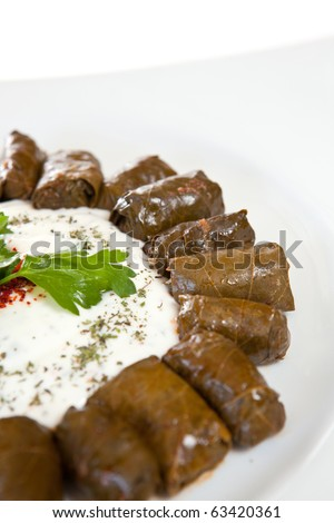 Dolmades of vine leaves stuffed with rice - stock photo