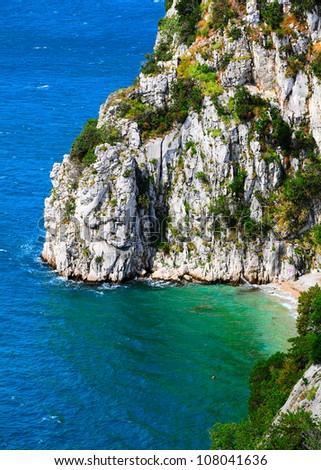Dolomite cliff in nature sanctuary the Rilke path over the Adriatic sea. Bay of Sistiana, Trieste, Italy. - stock photo