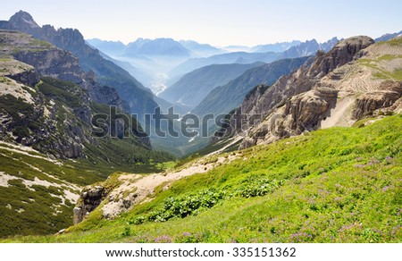 Dolomites mountains, view of great valley, Italy - stock photo