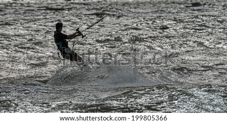 Dolzhanskaya spit, Russia - June 13, 2014: Strong wind in summer attracts many lovers of windsurfing and kitesurfing in the Dolzhanka, Krasnodar region, Russia.