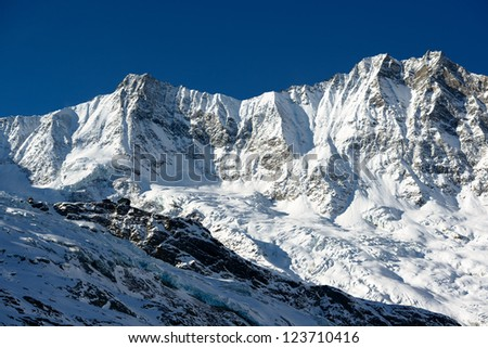 Dom and Taeschorn mountain peaks with Laengflueh in winter. Saas Fee, Switzerland - stock photo