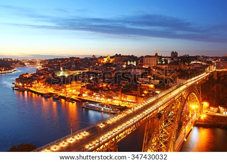 Dom Luis Bridge (Ponte Luis I) and bird eye view of Porto in the evening, Portugal  - stock photo