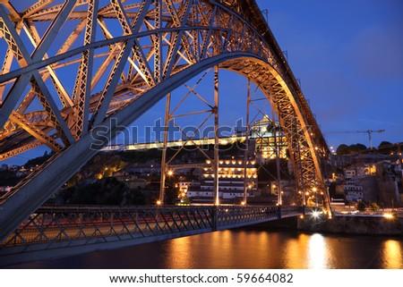 Dom Luis I bridge illuminated at night. Porto, Portugal - stock photo