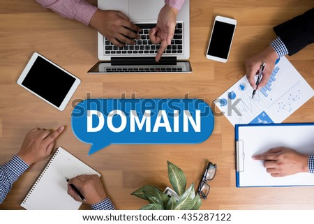 DOMAIN Business team hands at work with financial reports and a laptop, top view - stock photo