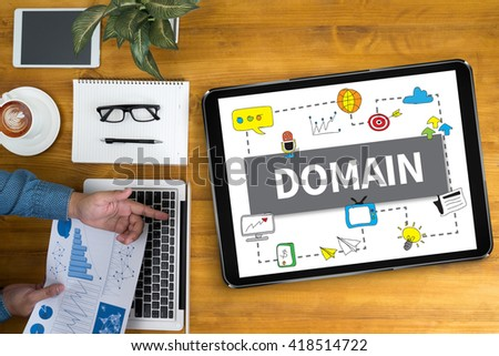 DOMAIN Businessman working at office desk and using computer and objects, coffee, top view, - stock photo