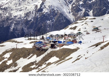 DOMBAY, RUSSIA - May 03.2015: Small village with cafes. Recreational accommodation for skiers on the mountain Mussa-Achitara - stock photo