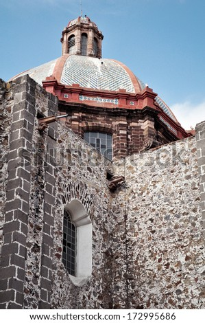 Dome and rear view of a church in the historic Mexican city of San Miguel de Allende. - stock photo