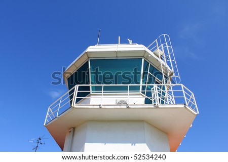 Dome of airport control tower against clear blue sky - stock photo