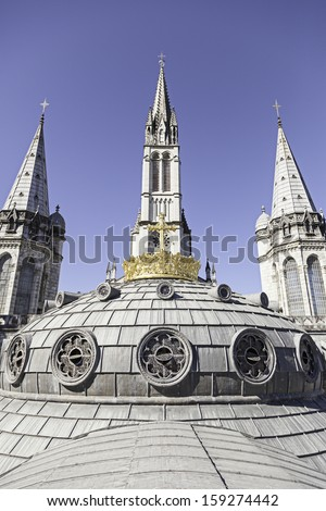 Dome of Lourdes Church, detail of a roof of a Christian church, belief and faith - stock photo
