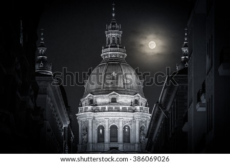 Dome of Saint Stephen basilica in night, Budapest, Hungary, Europe travel. Old town architecture foreground and night sky with moon background. - stock photo