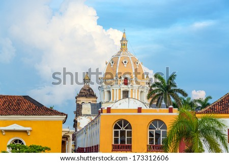 Dome of San Pedro church and historic colonial buildings in the center of Cartagena, Colombia - stock photo