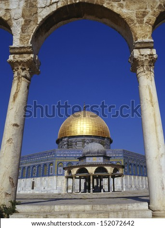 Dome of the Rock is a shrine on Temple Mount in the old city of Jerusalem. It has great significance for Jews, Christians and Muslims. It is the most contested piece of real estate on earth. - stock photo