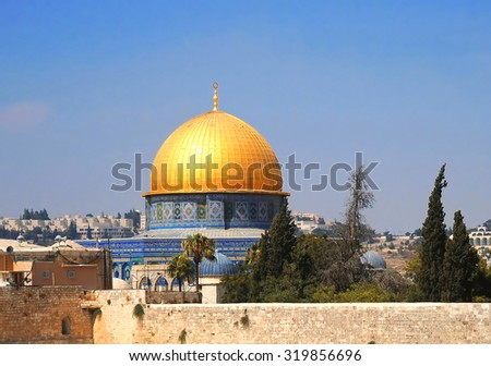 Dome of the Rock Mosque and Dome of the Chain on the Temple Mount behind the Western Wall in Jerusalem, Israel in a clear sky - stock photo