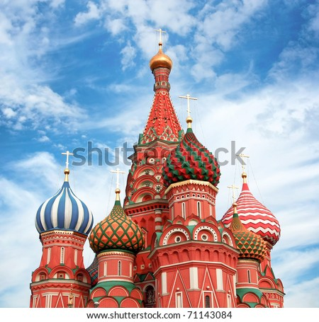 Domes of the famous Head of St. Basil's Cathedral over cloudy sky - stock photo
