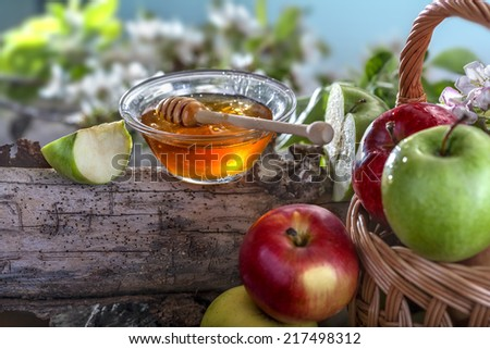 Domestic apples and honey on the natural rustic background - stock photo