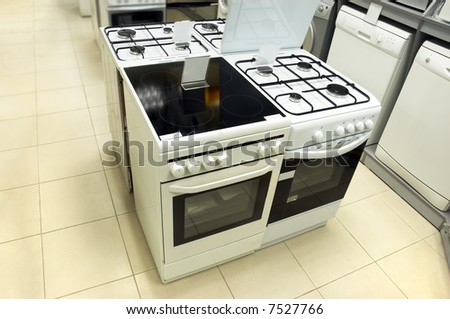 Domestic equipment (washing machines and gas stoves) arranged in the store - stock photo