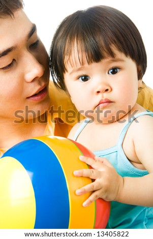 Domestic portrait of father and daughter holding the ball - stock photo