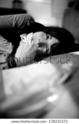 Domestic violence at home woman bond with rope crying - stock photo