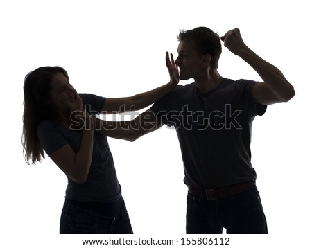 Domestic violence, man beating woman - stock photo