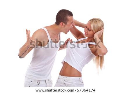 Domestic violence - picture of a man screaming and pulling his girlfriend's shirt - stock photo