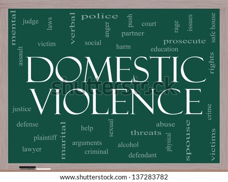 Domestic Violence Word Cloud Concept on a Blackboard with great terms such as victim, assault, judge, harm, social, education and more. - stock photo