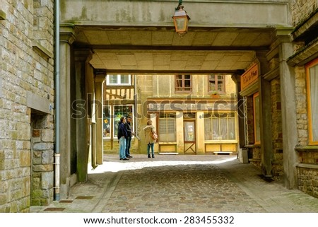 DOMFRONT, FRANCE - MAY 11. The medieval town of Domfront, in the Suisse Normandy region of France, welcomes visitors from around the world. May 11, 2015 in Domfront, France. - stock photo