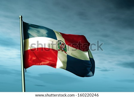 Dominican Republic flag waving on the wind - stock photo