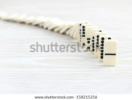 Domino concept Start from scratch falling - stock photo