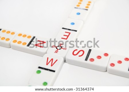 domino crossroads with compass - stock photo