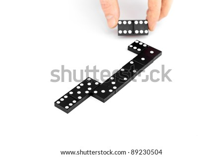 domino, domino line up curve and a pile of black wooden domino. - stock photo