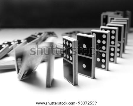 Domino (5) - falling dominoes - stock photo