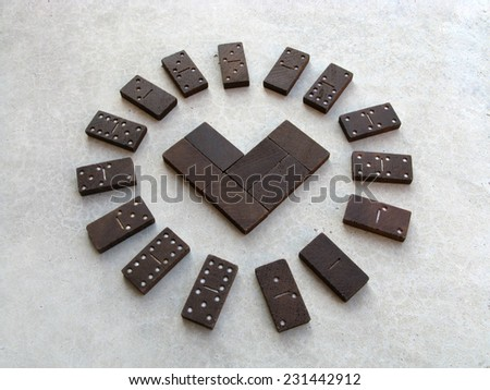 domino heart in circle of dominoes  - stock photo