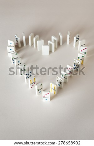 domino in the shape of a love heart - stock photo