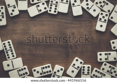domino pieces on the brown wooden table - stock photo