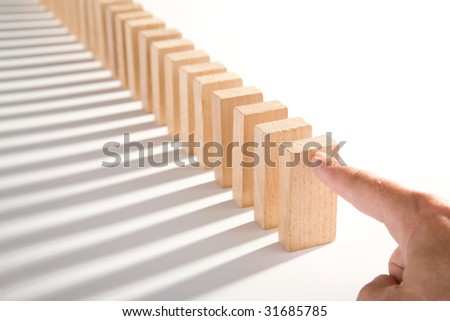 dominoes isolated on white as an abstract concept - stock photo