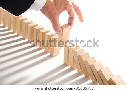 dominoes isolated on white as an abstract management concept - stock photo