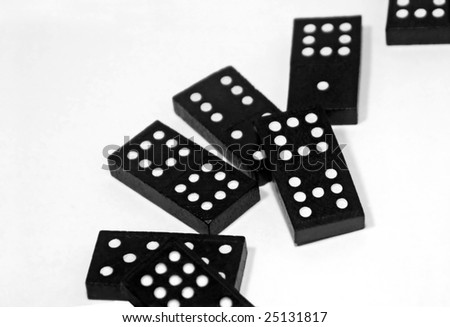 dominoes scattered on white background, focus on center right brick - stock photo