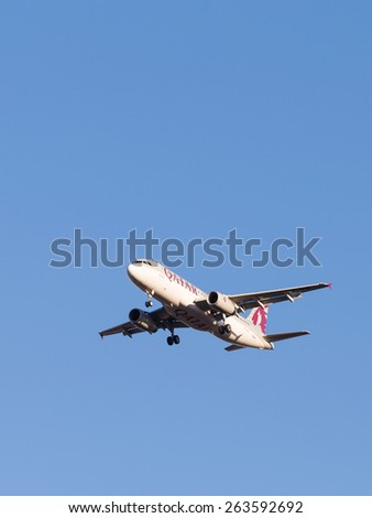 Domodedovo - March 17, 2015: Beautiful large passenger aircraft Airbus A320, the airline Qatar Airways, landing at Domodedovo airport March 17, 2015, Domodedovo, Moscow Region, Russia - stock photo