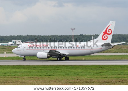 DOMODEDOVO, RUSSIA - JULY 20: Aircraft operated by Kyrgyzstan Aircompany, ready to take off from Moscow airport Domodedovo on July 20, 2013. The company in its fleet has 4 aircraft Boeing-737 - stock photo