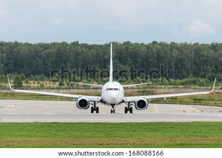 DOMODEDOVO, RUSSIA - JULY 20: Aircraft operated by NordStar Airlines, ready to take off at Moscow airport in Domodedovo on July 20, 2013. The company in its fleet has 9 aircraft Boeing-737-800 - stock photo
