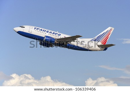 DOMODEDOVO, RUSSIA - SEPTEMBER 1: Aircraft operated by Transaero, taking off at Moscow airport in Domodedovo on September 01, 2011. The company in its fleet has 33 aircraft Boeing-737