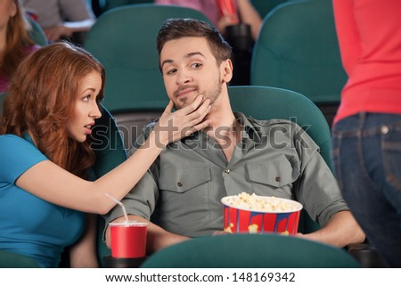 Don�¯�¿�½ look at her! Handsome young men looking at beautiful girl passing by while sitting near his girlfriend - stock photo