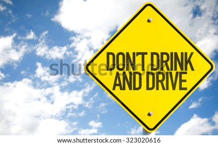 Don't Drink And Drive sign with sky background - stock photo