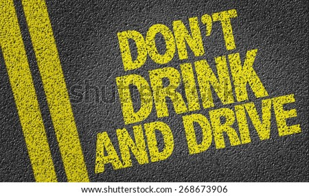 Don't Drink and Drive written on the road - stock photo