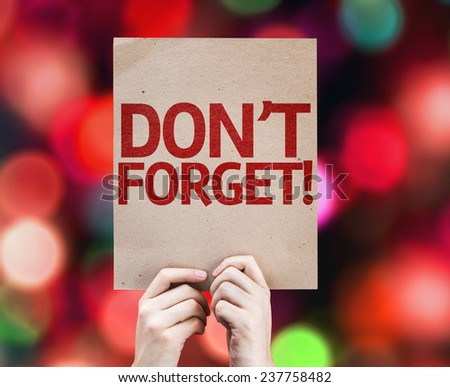 Don't Forget! card with colorful background with defocused lights - stock photo