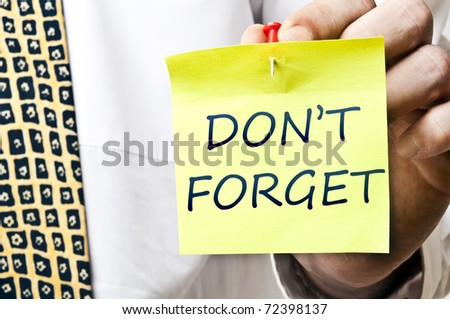 Don't forget post it in business man hand - stock photo